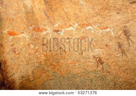 Bushmen rock painting of human figures and antelopes, Brandberg archaeological site, Namibia, southern Africa
