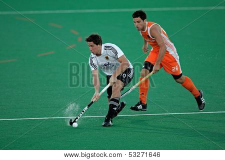 BLOEMFONTEIN, SOUTH AFRICA - JANUARY 16: Unidentified players during a men's field hockey game between Germany and Netherlands (Netherlands won 2-1) on January 16, 2010 in Bloemfontein, South Africa.