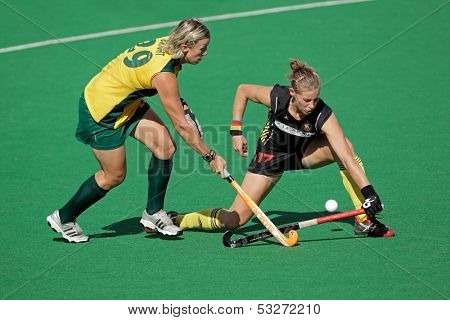 BLOEMFONTEIN, SOUTH AFRICA - FEBRUARY 7: Tarryn Bright (L) and A van Regemortel (R) during a women's field hockey match between South Africa and Belgium, Bloemfontein, South Africa, 7 February 2011