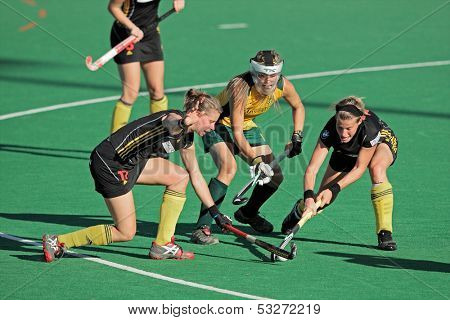 BLOEMFONTEIN, SOUTH AFRICA - FEBRUARY 7: A van Regemortel (L), L Deetlefs (M), G Valcke (R) during a women's field hockey match, South Africa vs. Belgium, Bloemfontein, South Africa, 7 February 2011