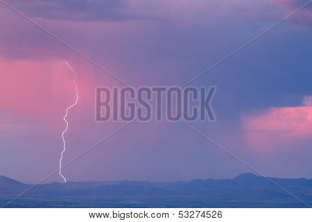 Thunderstorm with lightning and heavy rainclouds at sunset