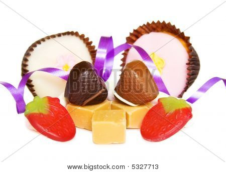 Heart Shaped Chocolates And Purple Ribbons For A Special Day