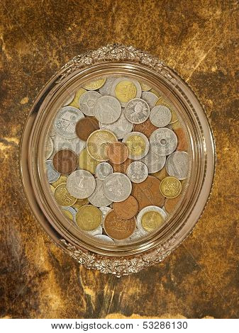 Golden Oval Photo Frame With Numismatic Coins Collection Inside.