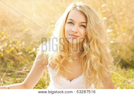 Portrait of Happy Woman on Nature Background