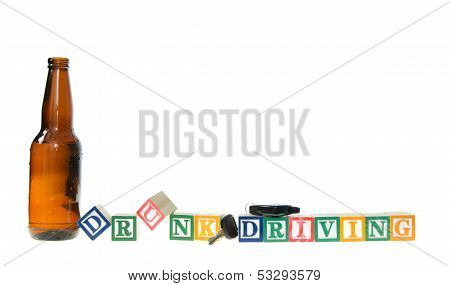 Letter Blocks Spelling Drunk Driving With Keys And A Beer Bottle
