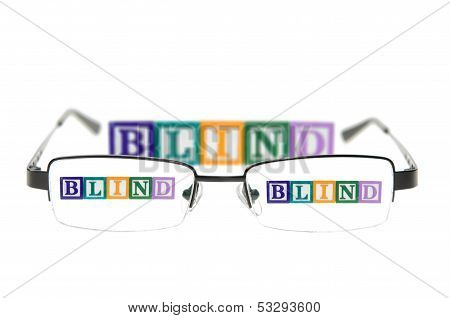 Letter Blocks Spelling Blind Through A Pair Of Glasses