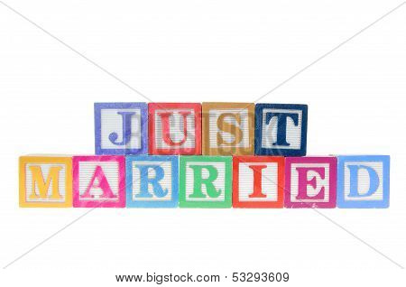 Letter Blocks Spelling Just Married Isolated On A White Background