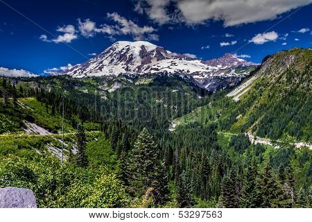 A Majestic Wide Angle View of Snow Capped Mount Rainier and a Deep River Valley