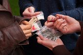 stock photo of heroin  - Drug dealer selling pillsmarijuana and cocaine to teens - JPG
