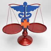 Scales of justice and medical cross