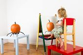 picture of impressionist  - Little toddler girl painting pumpking on a whiteboard with a impressionist style - JPG