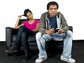 stock photo of indoor games  - young couple or siblings playing video games - JPG