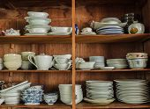 pic of crockery  - Wooden crockery in the pantry in the kitchen - JPG