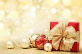 stock photo of christmas greeting  - Decorated Christmas gifts on abstract background - JPG