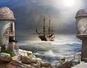 stock photo of sailing vessels  - A pirate or merchant ship anchored in the bay of a fort - JPG