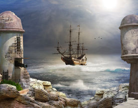 stock photo of historical ship  - A pirate or merchant ship anchored in the bay of a fort - JPG