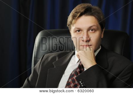 Portrait Of The Businessman On A Dark Background