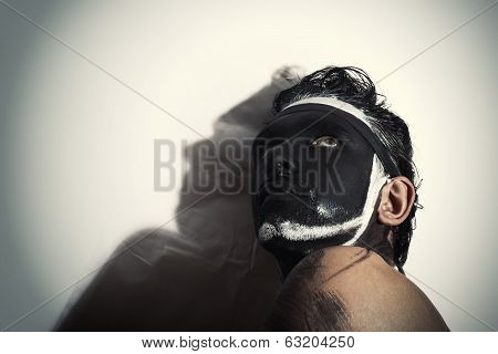 Portrait Of Man With Black Theatrical Makeup