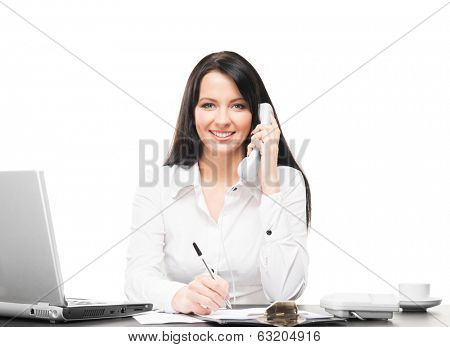 Young and attractive business woman working in office isolated on white