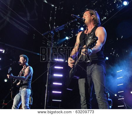 LAS VEGAS-APR 4: Brian Kelley (L) and Tyler Hubbard of Florida Georgia Line perform at the 2nd Annual Academy of Country Music (ACM) Party For A Cause Festival at The LINQ in Las Vegas, Nevada.