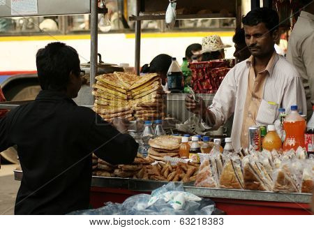 Indian street Vendor sell bakery food in a crowded road