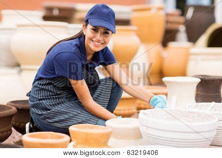 pretty young hardware store worker working in home and garden center