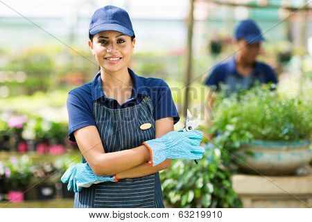 cute female nursery worker portrait with pruner