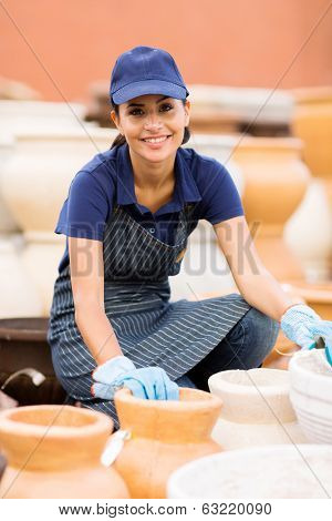 beautiful young hardware store worker selling clay pot