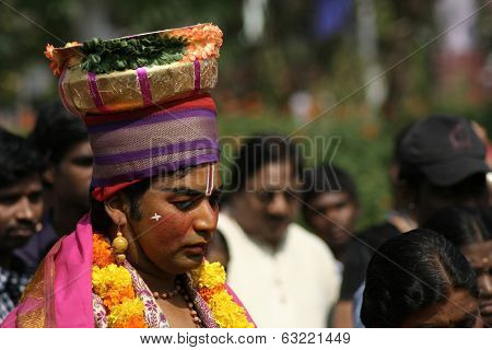 Haridasa singing Hindu prayers during pongal festival