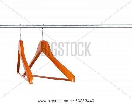Coat hanger on clothes a rail against white