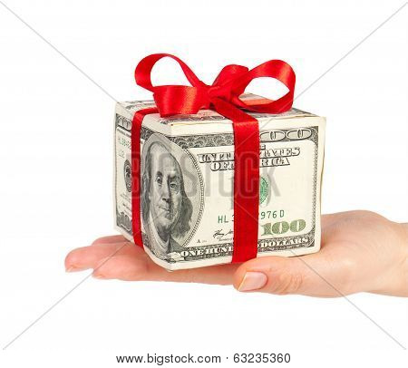 Money concept dollars in the form of a gift box in hand isolated on white