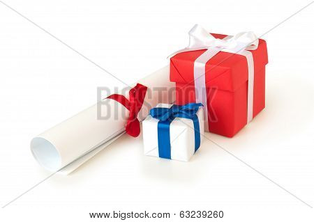 gift boxes with ribbons and roll of paper isolated on white