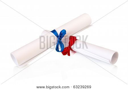 wo rolls of white paper with ribbon and bow