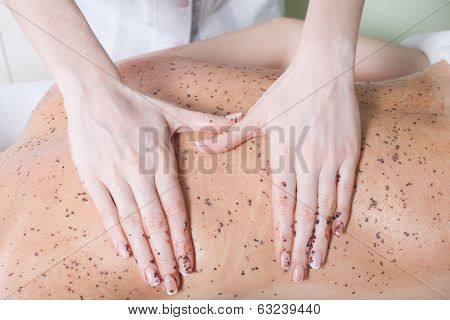 woman getting a chocolate massage at spa