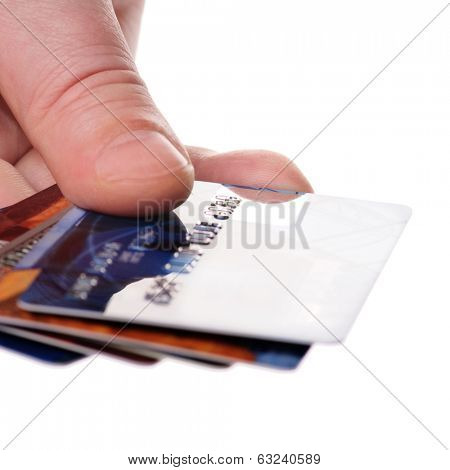 A hand with unreadable credit plastic card