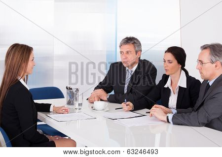 Businesspeople Interviewing Woman