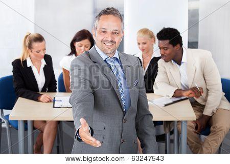 Mature Businessman Offering Handshake