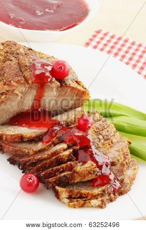 Meat with cranberries sauce