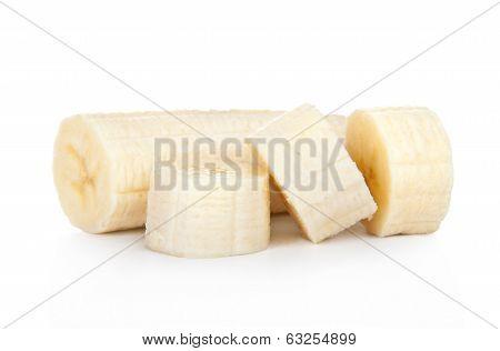 Freshly sliced bananas on a white background