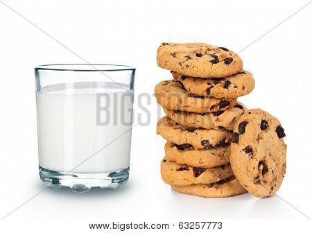 Glass of milk and cookies on white background