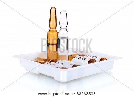 Transparent medical ampoules on an isolated white, medicine