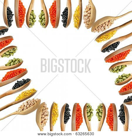 Abstract frame of beans, legumes, peas, lentils on wooden spoons isolated on white background
