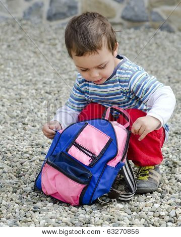 Child Opening His Bag