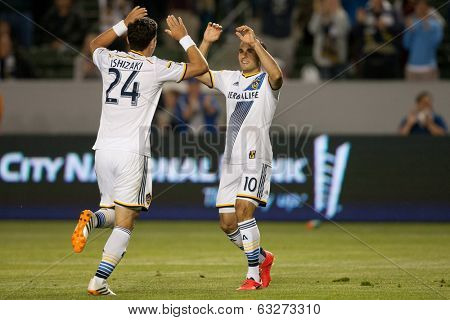 CARSON, CA - APRIL 12: Los Angeles Galaxy M Landon Donovan #10 & Los Angeles Galaxy M Stefan Ishizaki #24 during the MLS game between the Los Angeles Galaxy & the Vancouver Whitecaps on April 12 2014