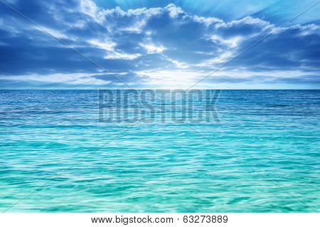 Sun rays through cumulonimbus clouds over sea, beautiful seascape, sunny day, beauty of nature, summer time concept
