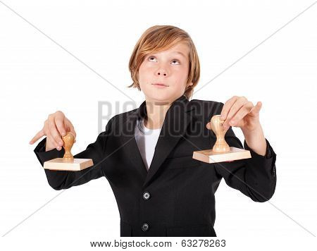 young boy holding rubber stamps
