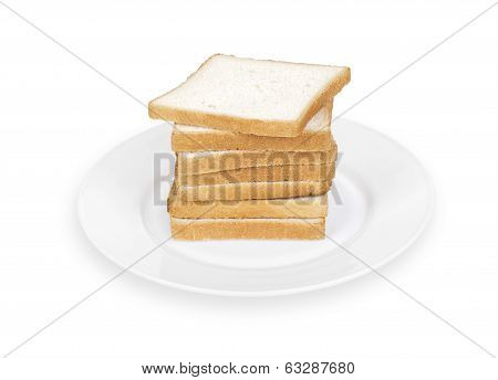 pieces of bread on a white plate on a white background isolated