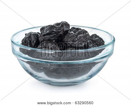Some prunes in plate isolated on white