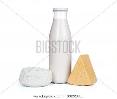 Slice of fresh cheese and milk bottle with glass isolated on white background