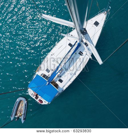 Anchored sail boat, view from top of the mast